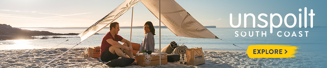 Couple enjoying a Hyams Beach Hamper on Blenheim Beach, South Coast NSW