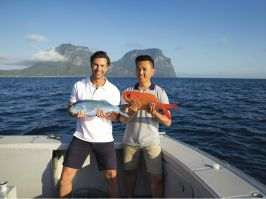 Friends with their deep sea fishing catch off Lord Howe Island