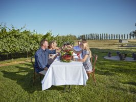 Couple enjoying Long Lunch, outdoors at Heifer Station in Orange NSW
