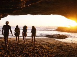 Watch the sunrise from a beach cave