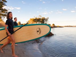 Couple enjoying SUP at Lake Illawarra