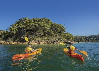 Friends kayaking on Pittwater near Sinclair Point, Great Mackerel Beach