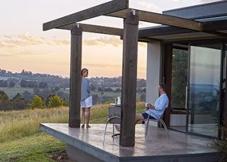 Couple enjoying the verenadah outdoors at Borrodell Vineyard Accommodation