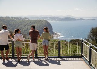 Friends enjoying the scenic coastal views from Captain Cook Lookout, Copacabana