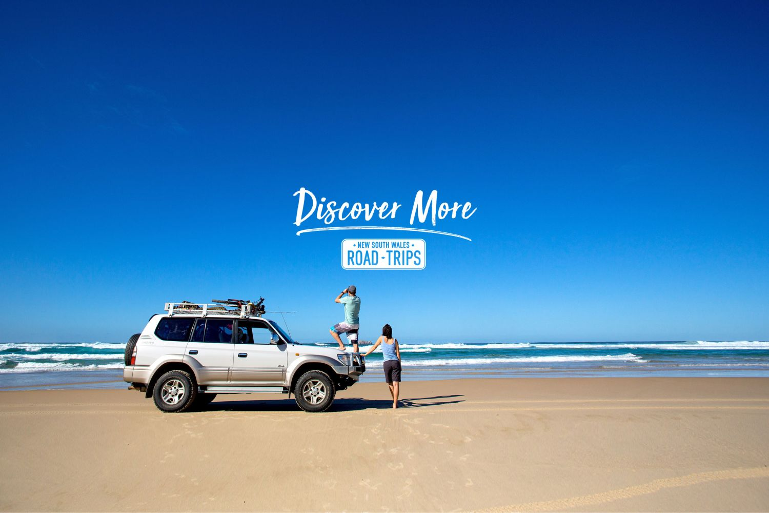 Couple on a 4WD accessible beach at Hat Head - Macleay Valley Coast