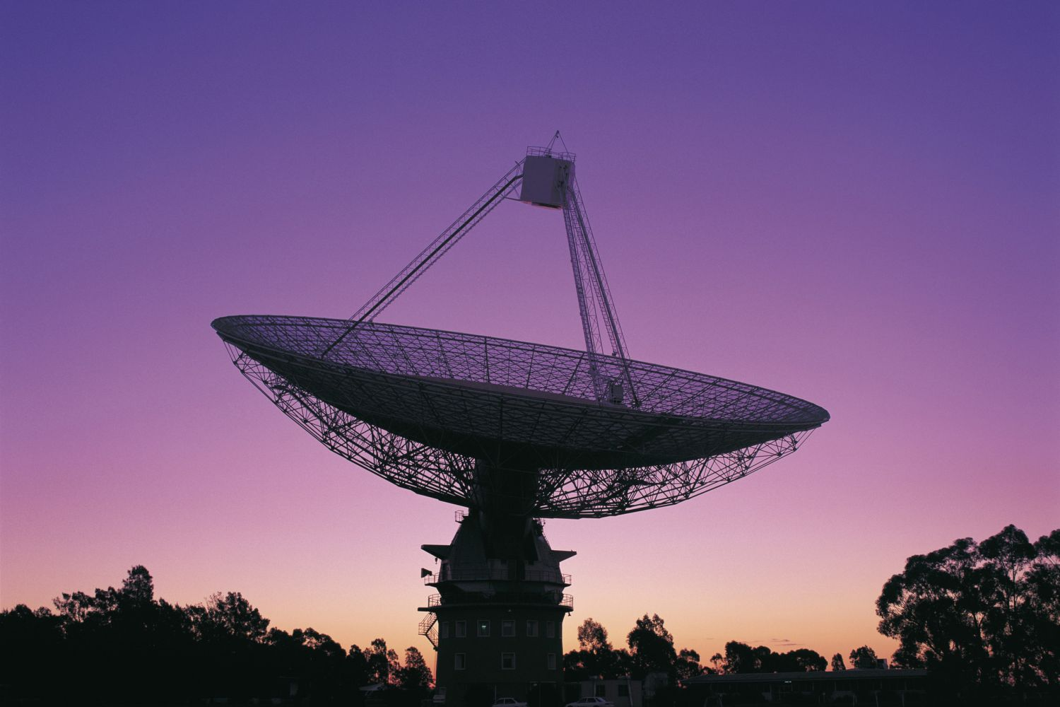 The CSIRO Parkes Observatory radio telescope pointing skyward, Parkes, Australia