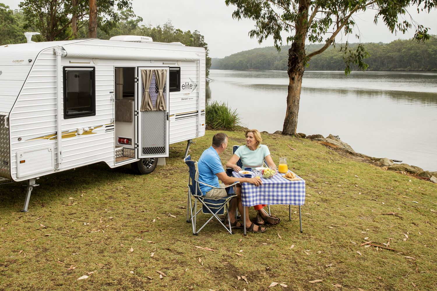 A couple enjoying breakfast by the Clyde River, near Batemans Bay
