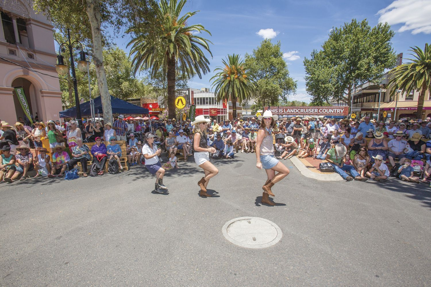 Women line dancing during the Tamworth Country Music Festival, Australia