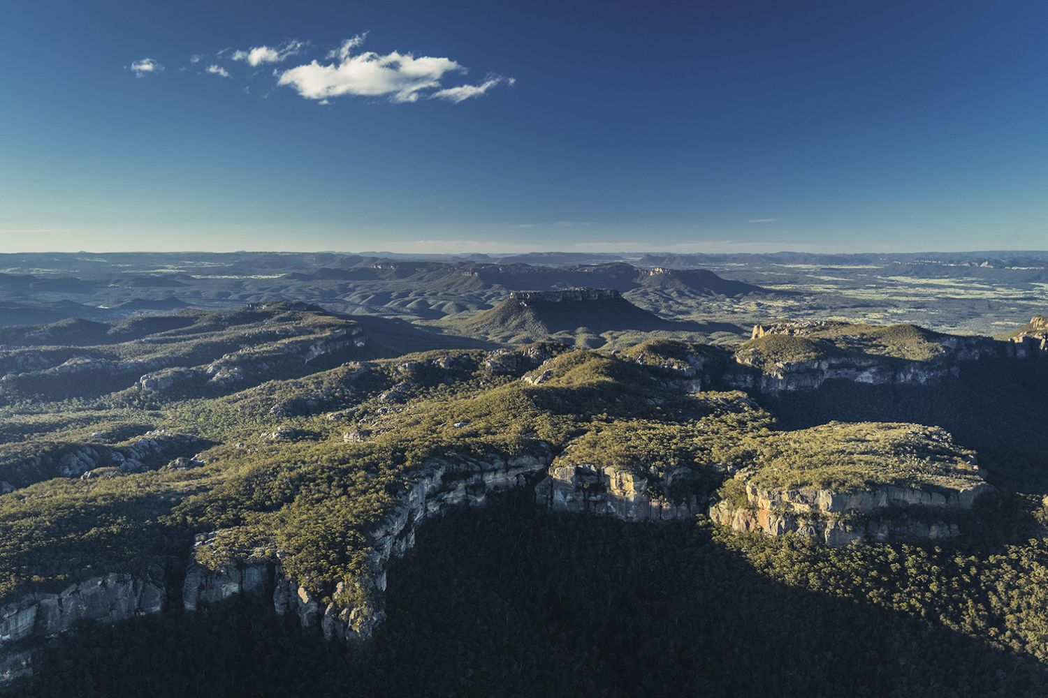 Sun rising over the World-Heritage listed Gardens of Stone National Park in Wolgan, Blue Mountains