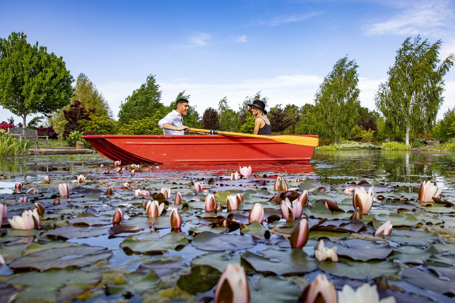 Couple rowing a boat on Mayfield Lake during the Spring Festival at Mayfield Garden, Oberon