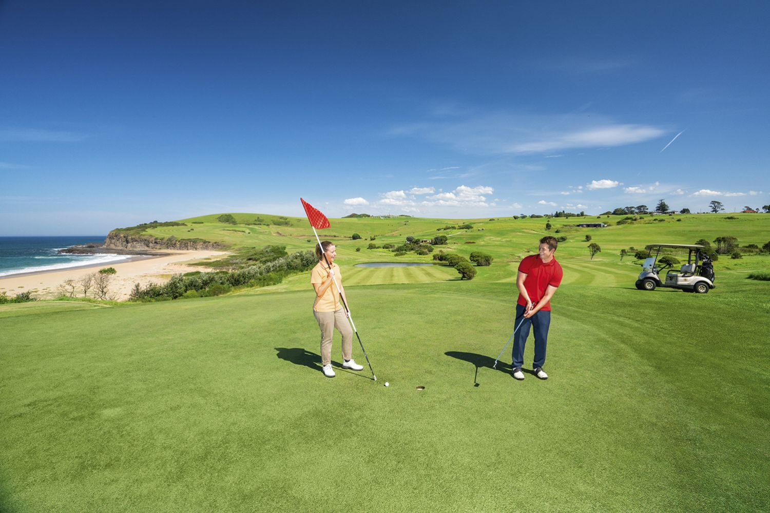 Couple enjoying a scenic round of golf at Kiama Golf Club on the South Coast