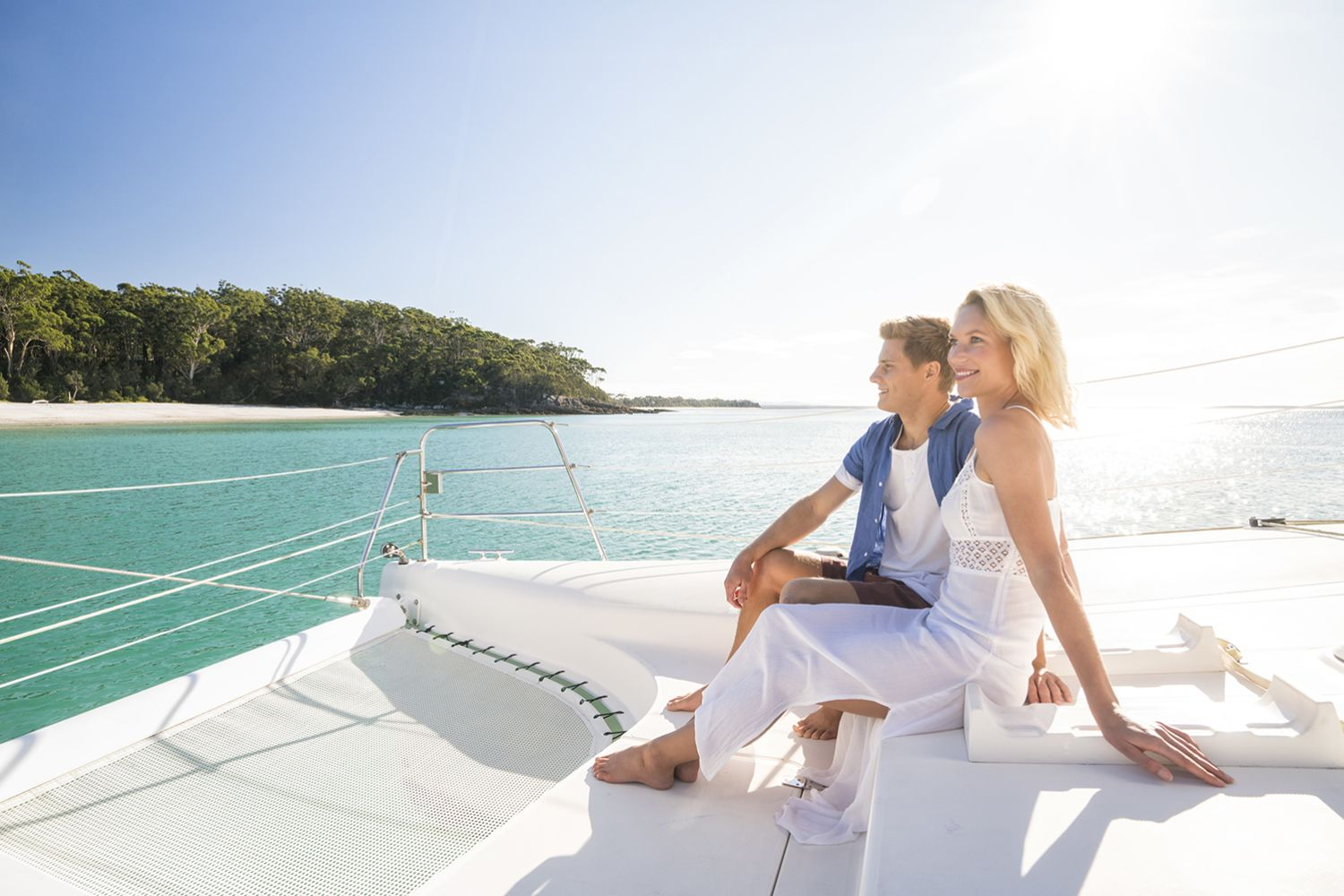 Couple enjoying a romantic day on the water with luxury sailing charter Discover Jervis Bay