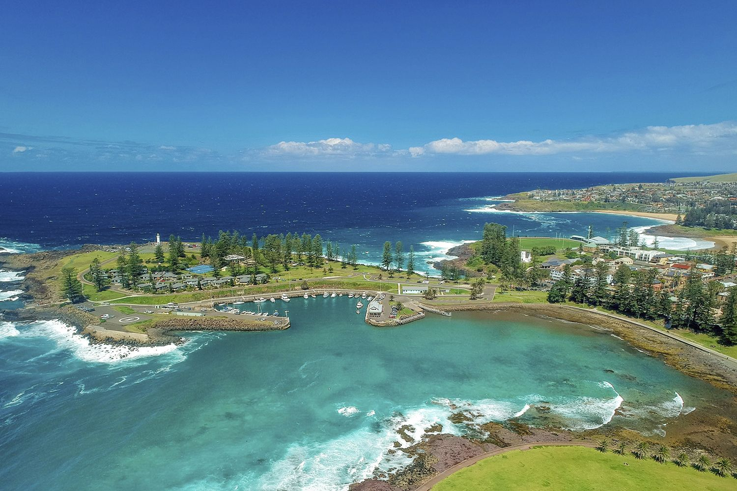 Aerial overlooking Kiama Harbour and the Continental Ocean Pool in Kiama
