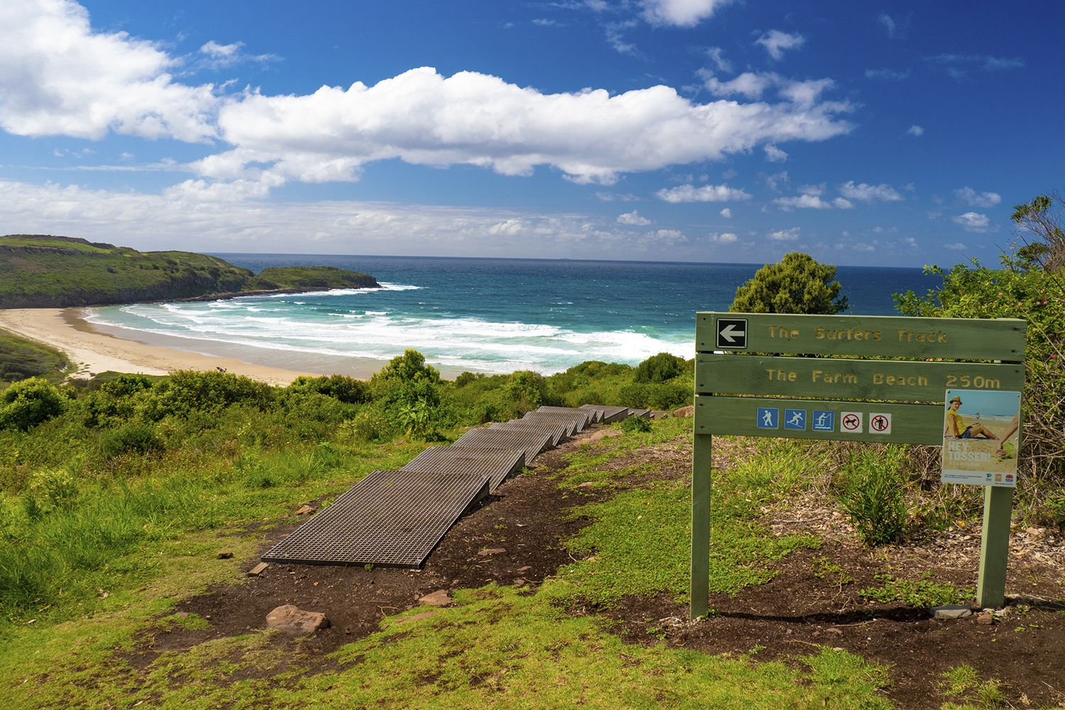 The surfers track down to Farm Beach in Killalea State Park, Shellharbour