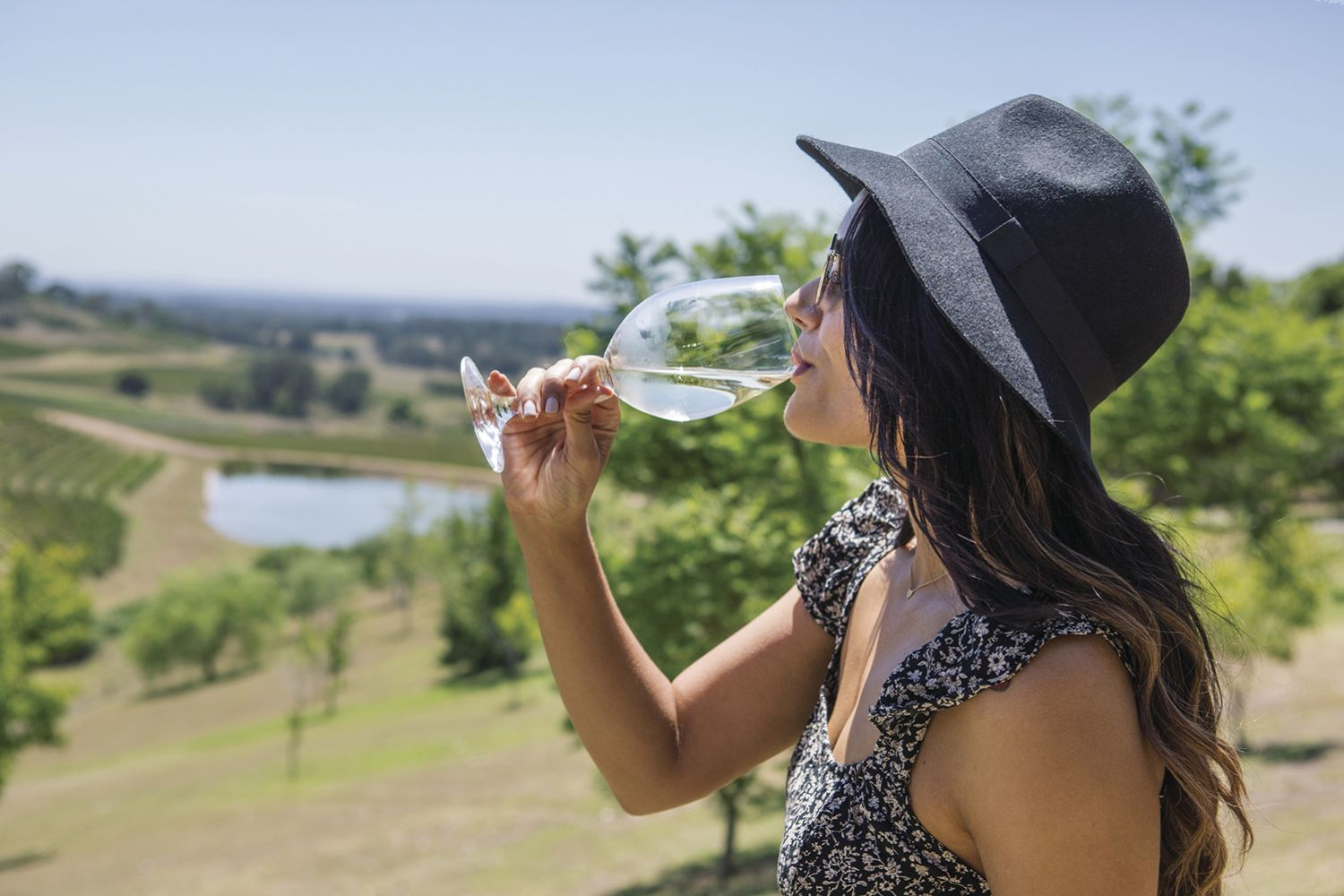 Woman enjoying the scenic views and wine at Bistro Molines, Mount View in the Hunter Valley
