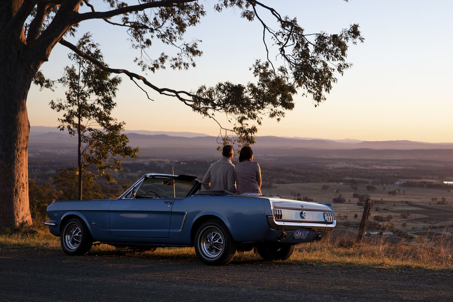 Couple enjoying views across Hunter Valley from Mount View Road, Pokolbin