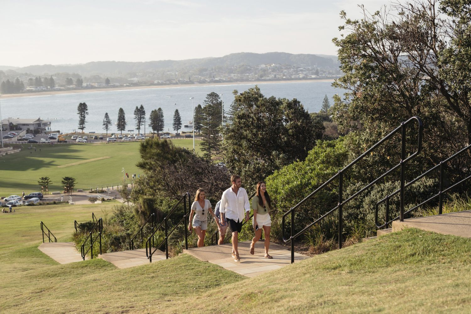 Friends walking to the lookout at the top of The Skillion in Terrigal, Central Coast