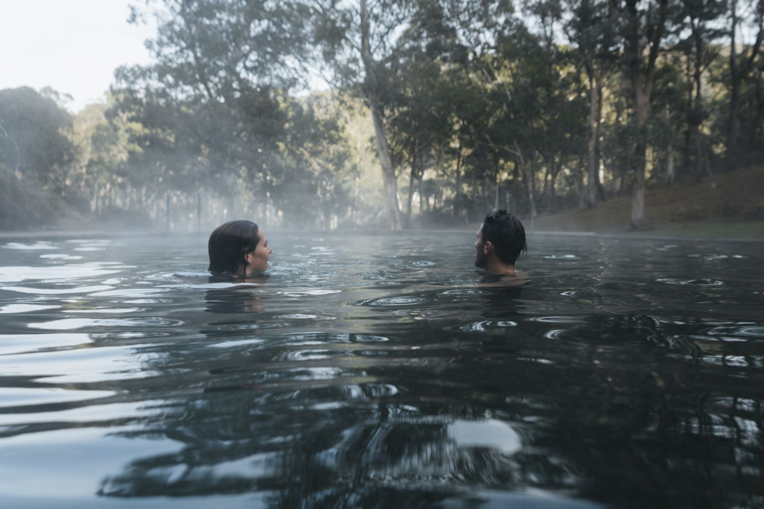 Couple enjoying a dip in the natural thermal springs in the Yarrongobilly area, Kosciuszko National Park