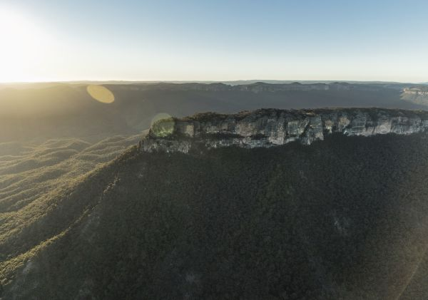 Sun rising over Pantoneys Crown tableland, Capertee Valley in the picturesque Gardens of Stone National Park.
