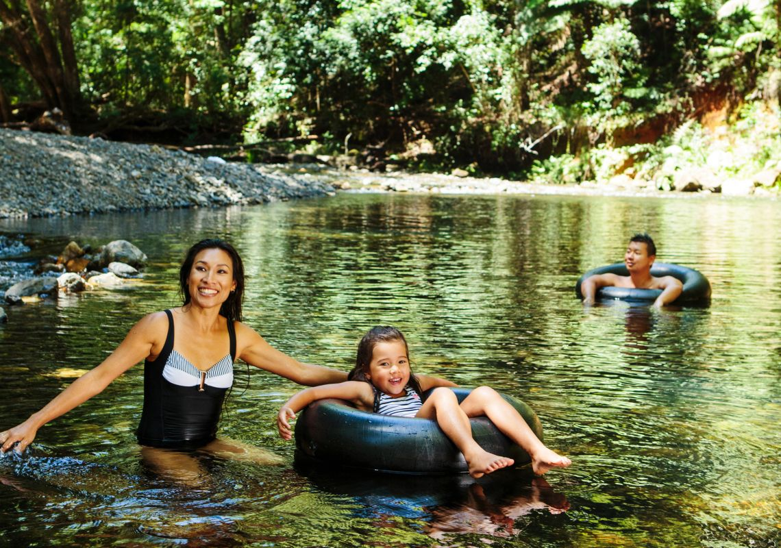 A family cools off in Bellinger River, NSW, Australia