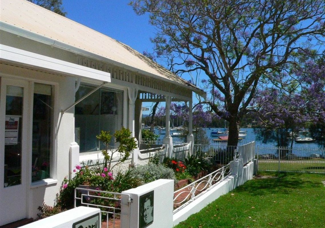 Entrance to Dobell House with views towards boats moored on Lake Macquarie
