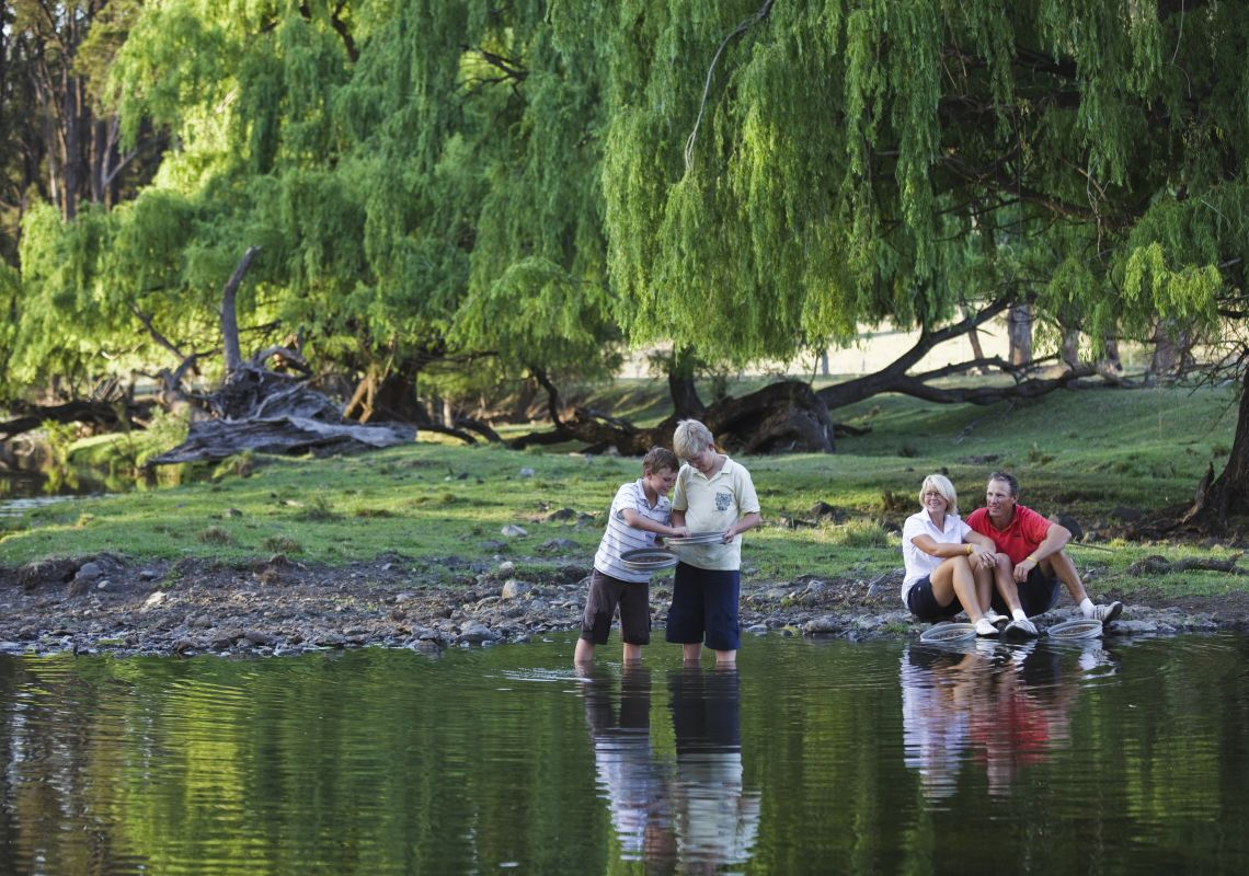 A family fossicking at a creek, near Inverell