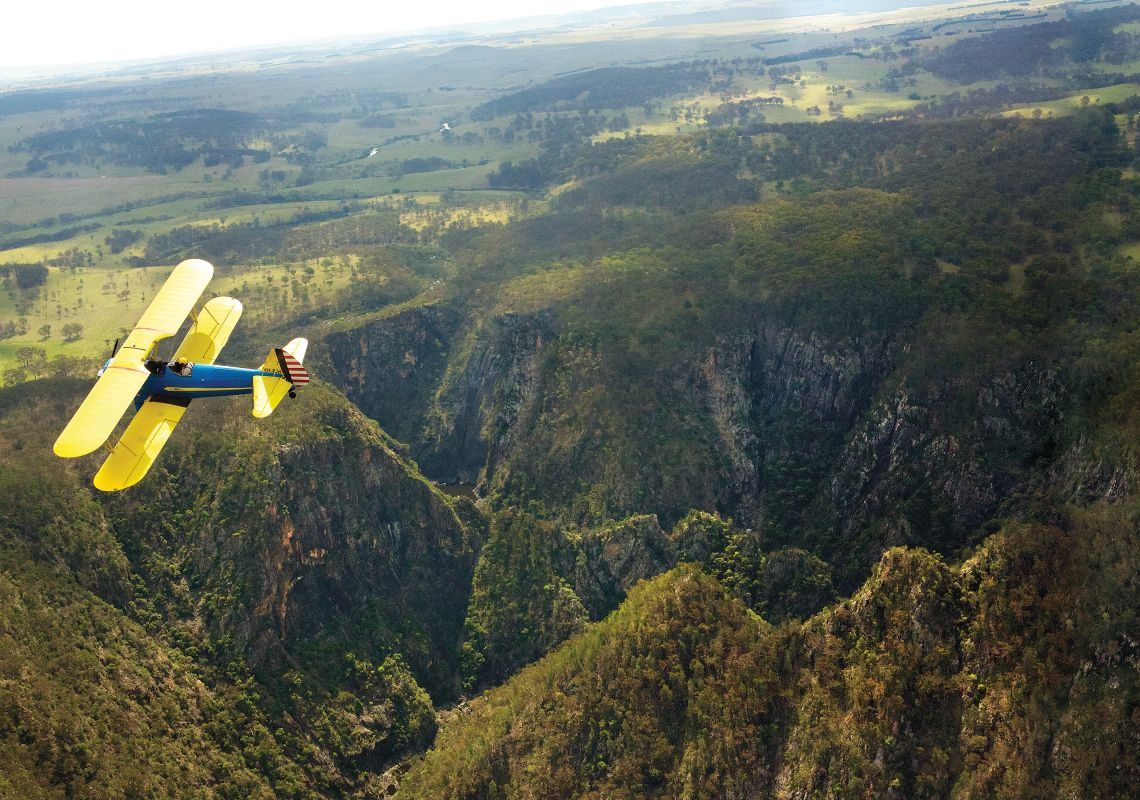 A biplane flying over Dangars Gorge, Oxley Wild Rivers National Park
