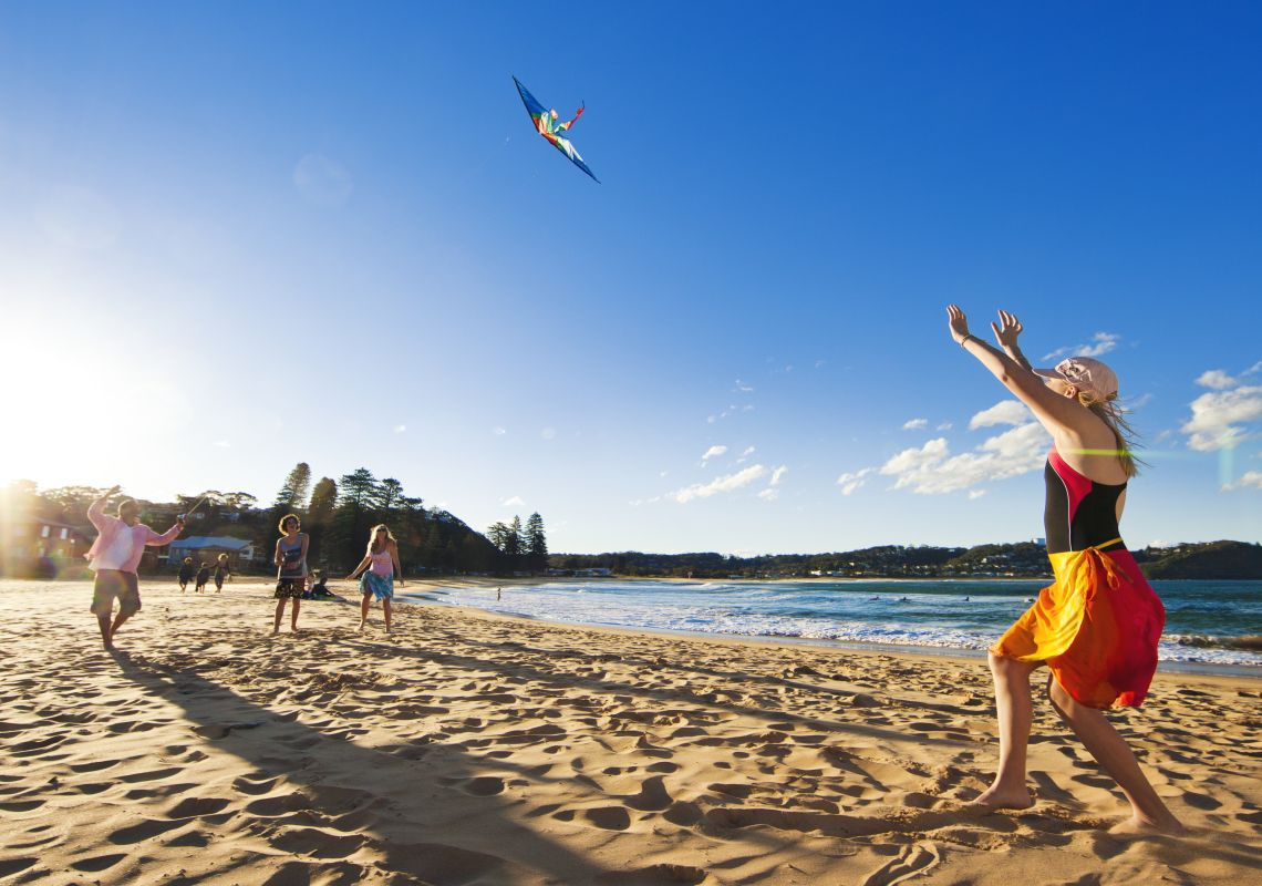 Family flying a kite - Avoca Beach - Gosford