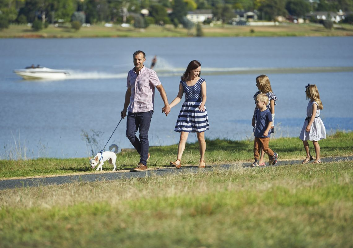 A family walking their dog by Lake Albert, Wagga Wagga