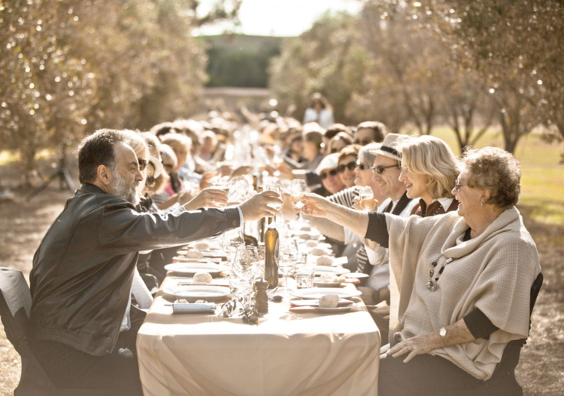 People enjoying the Olive Long Table Luncheon at Whispering Brook Winery in Broke, Hunter Valley