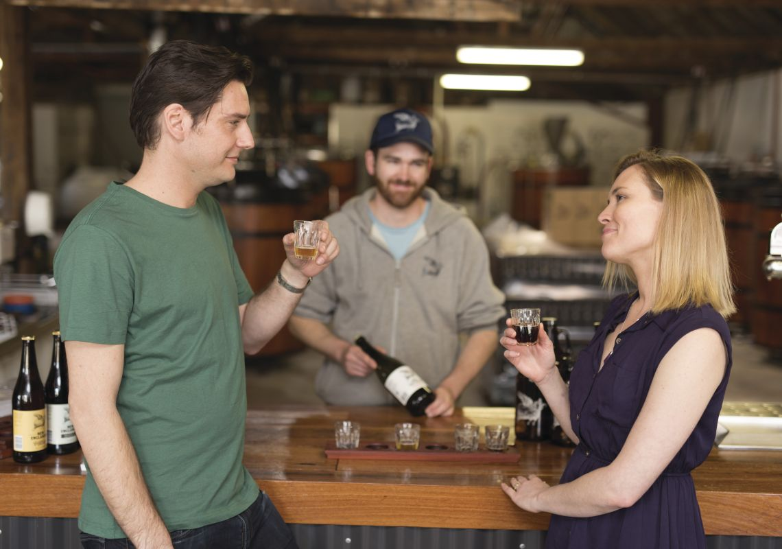 A couple tasting craft beer at the New England Brewing Co., Uralla