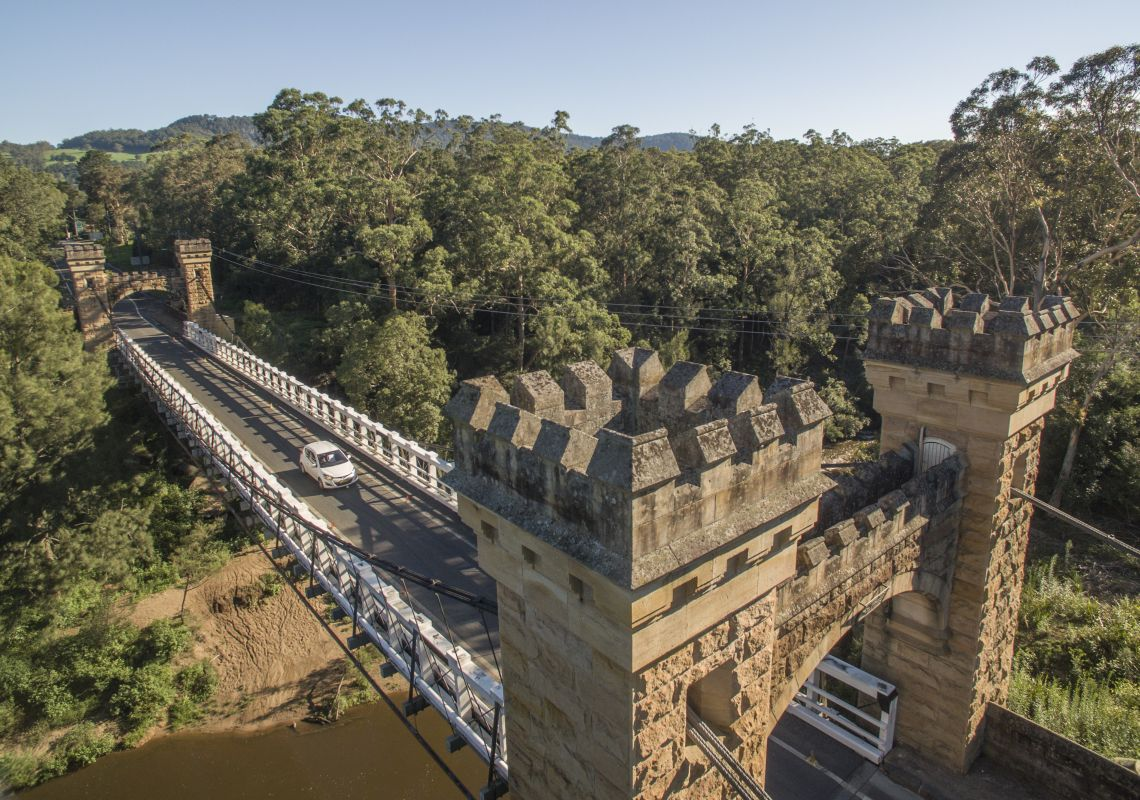 Car drives over the historic Hampden Bridge in Kangaroo Valley