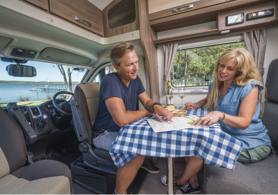 A couple looking at a map in their campervan, Port Stephens