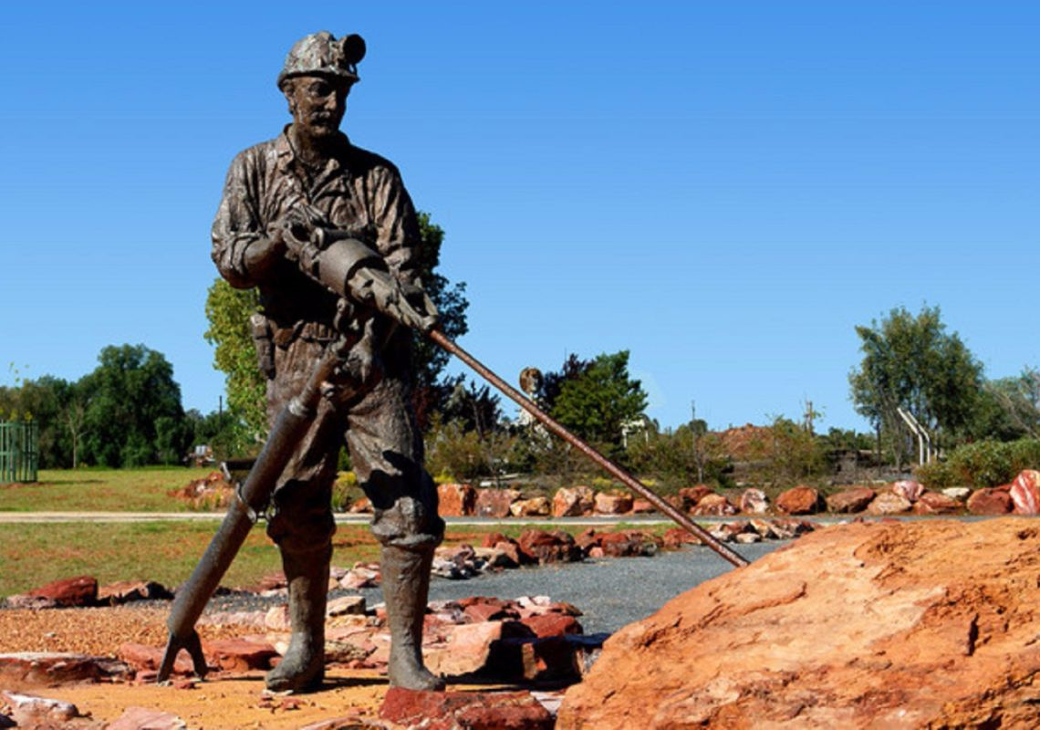 A bronze sculpture of a miner - Cobar Miners Memorial