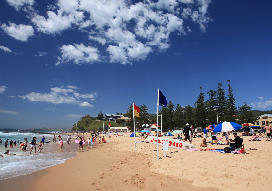 People relaxing on Austinmer Beach, Austinmer, in the Illawarra region