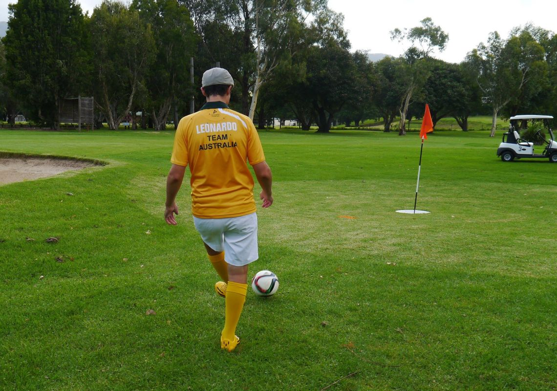 Man kicking ball at Jamberoo FootGolf, on the NSW South Coast
