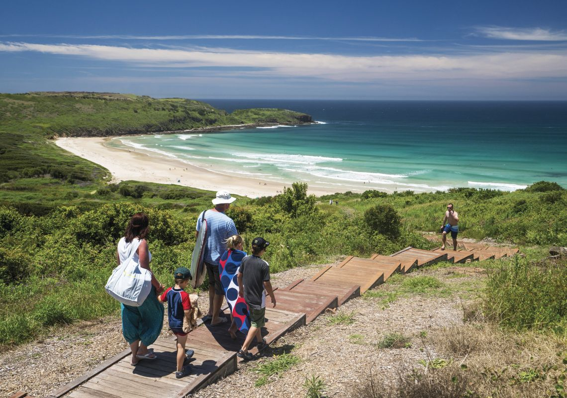 "Family headed to the ""The Farm"" beach at Killalea State Park in Shellharbour"