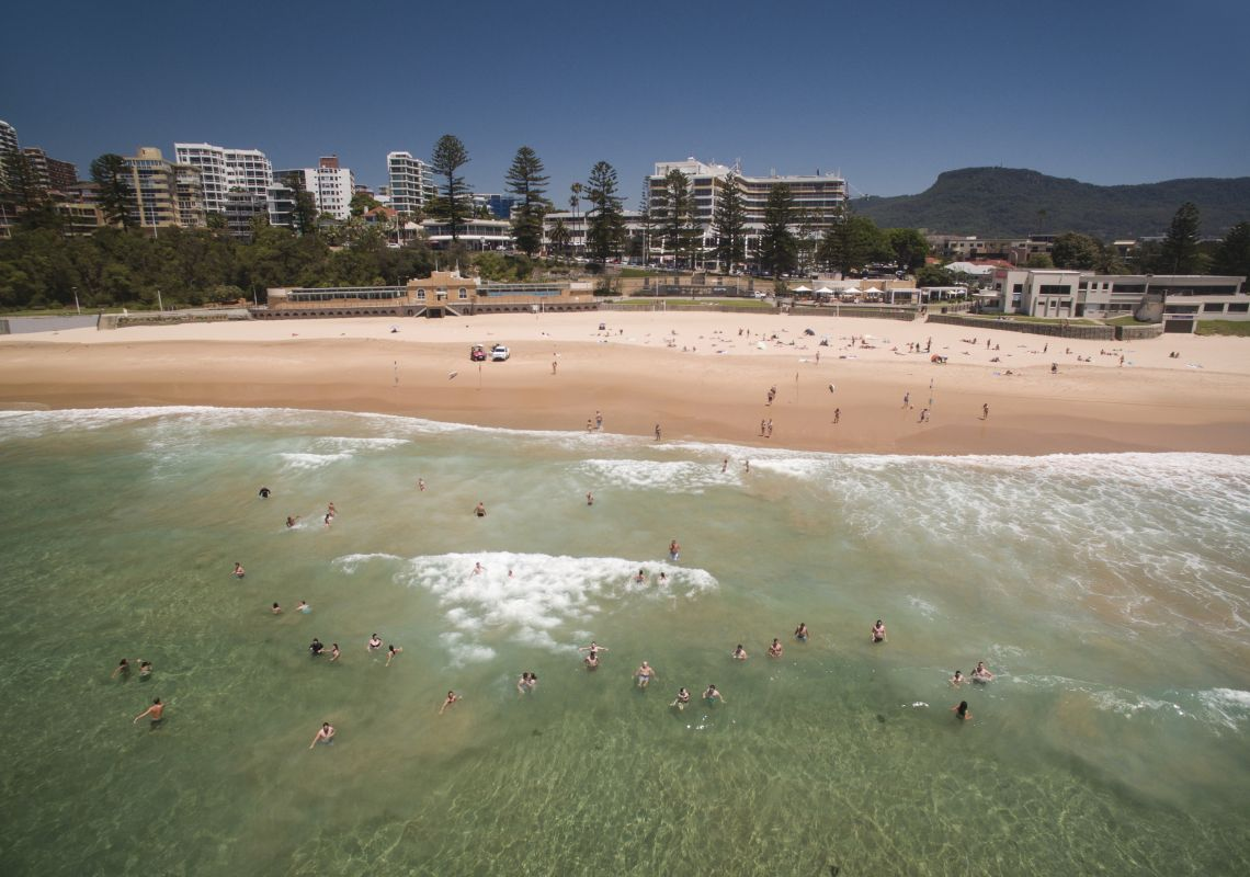 Swimmers enjoying the waves at North Wollongong Beach, in Wollongong