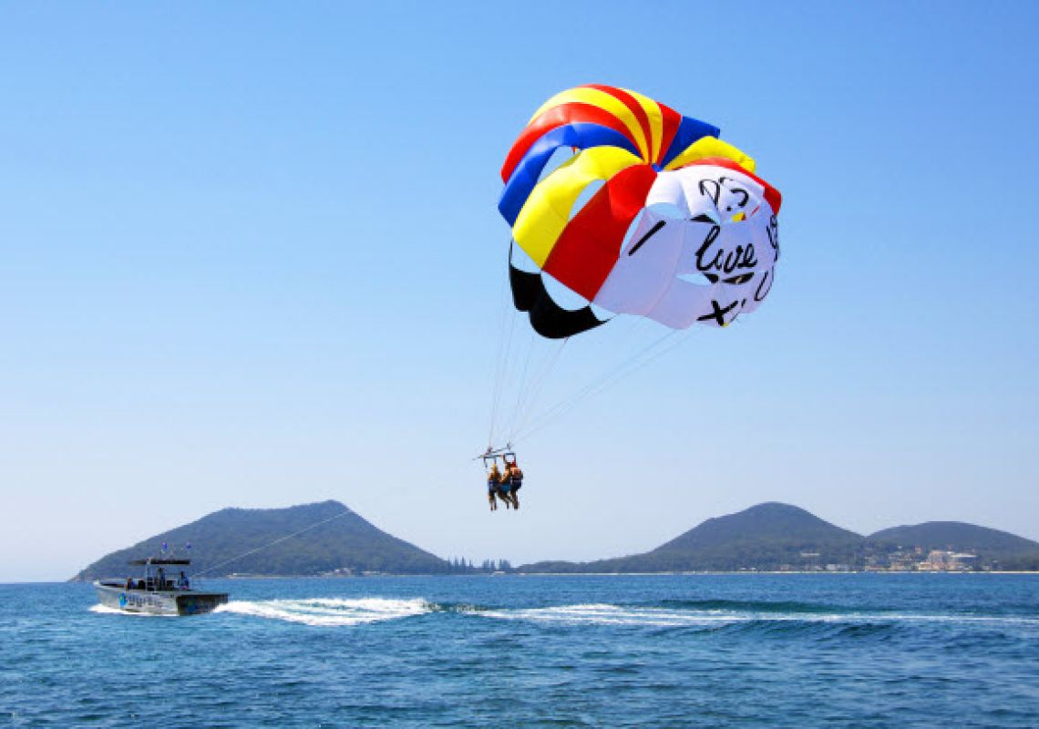 Couple enjoying a parasailing experience in Port Stephens