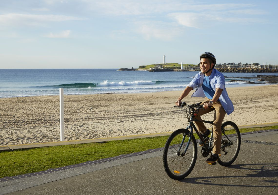 A cyclist riding on the promenade, North Wollongong Beach, Wollongong