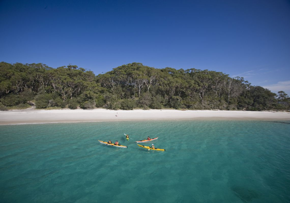 people kayaking at Murrays Beach in Booderee National Park, Jervis Bay