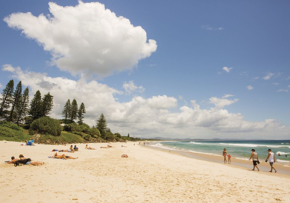 People enjoying a sunny day on Main Beach, Byron Bay