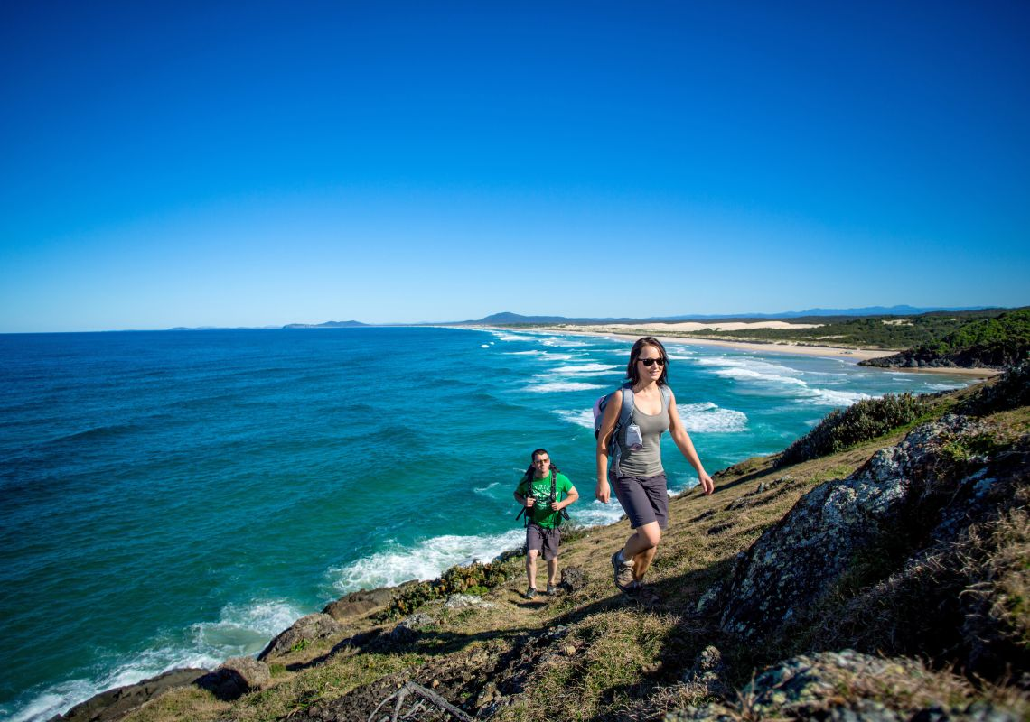Two bushwalkers exploring a headland, Hat Head National Park