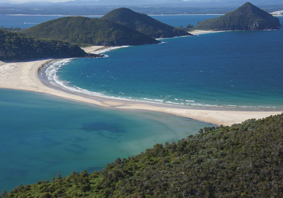 Coastal aerial of Fingal Spit with views towards Mount Tomaree, Port Stephens