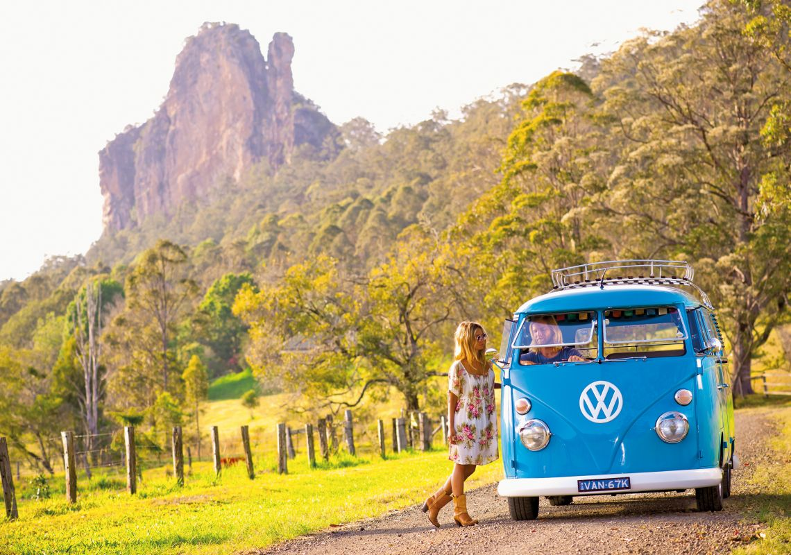 A couple and their VW kombi at Nimbin Rocks, Nimbin