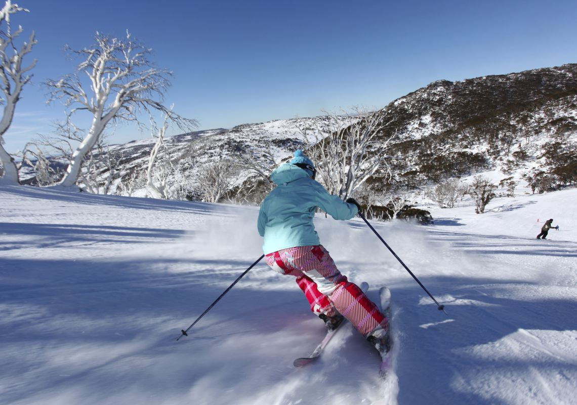 Woman skiing in Perisher in the NSW Snowy Mountains
