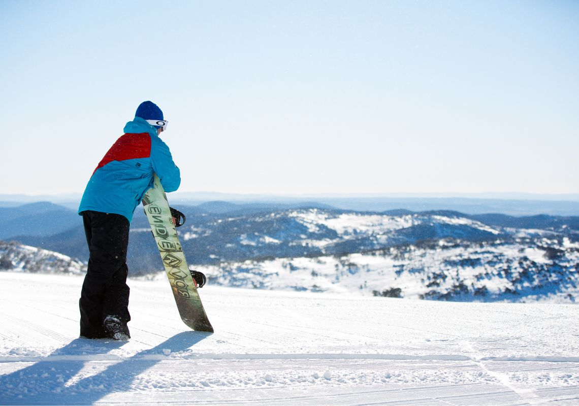 Snowboarder enjoying the view at Perisher in the NSW Snowy Mountains