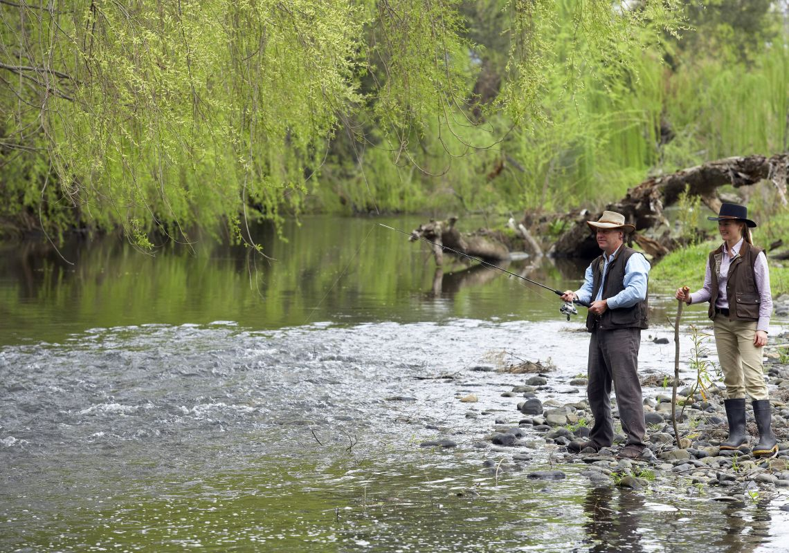 Couple fishing at the stream at Belltrees Estate in Scone, Upper Hunter