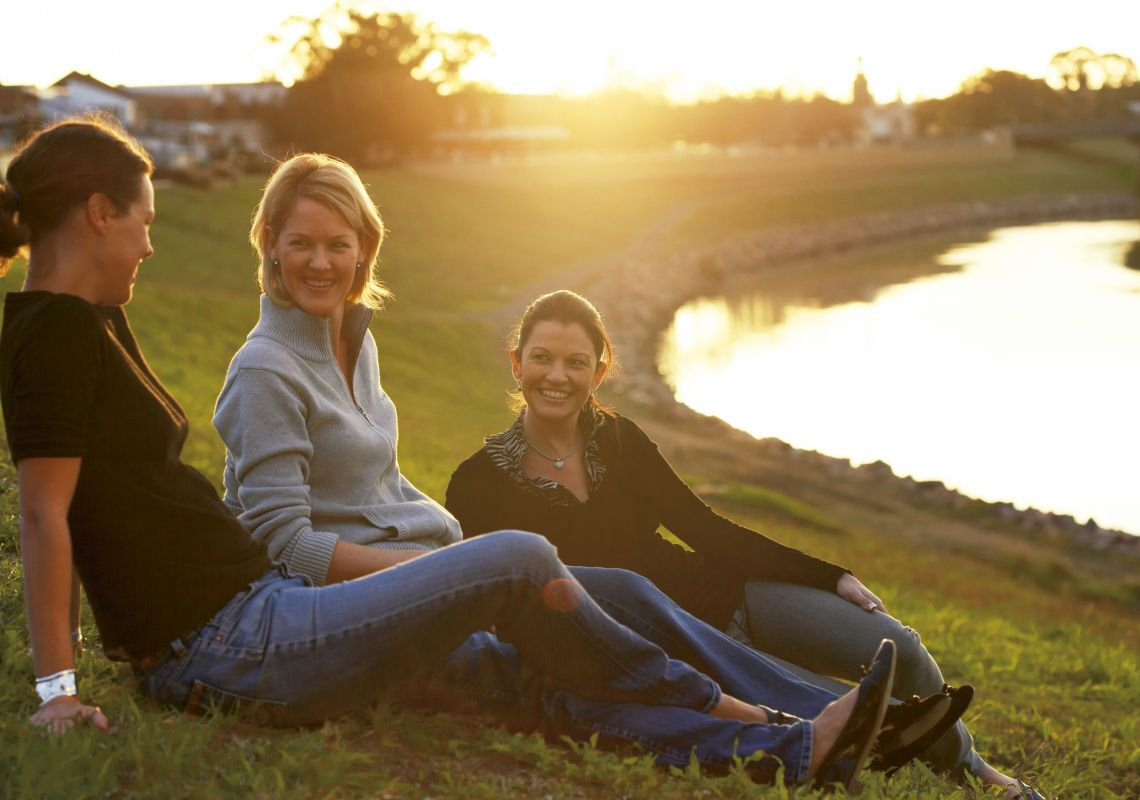 Friends relaxing by the Hunter River in Maitland