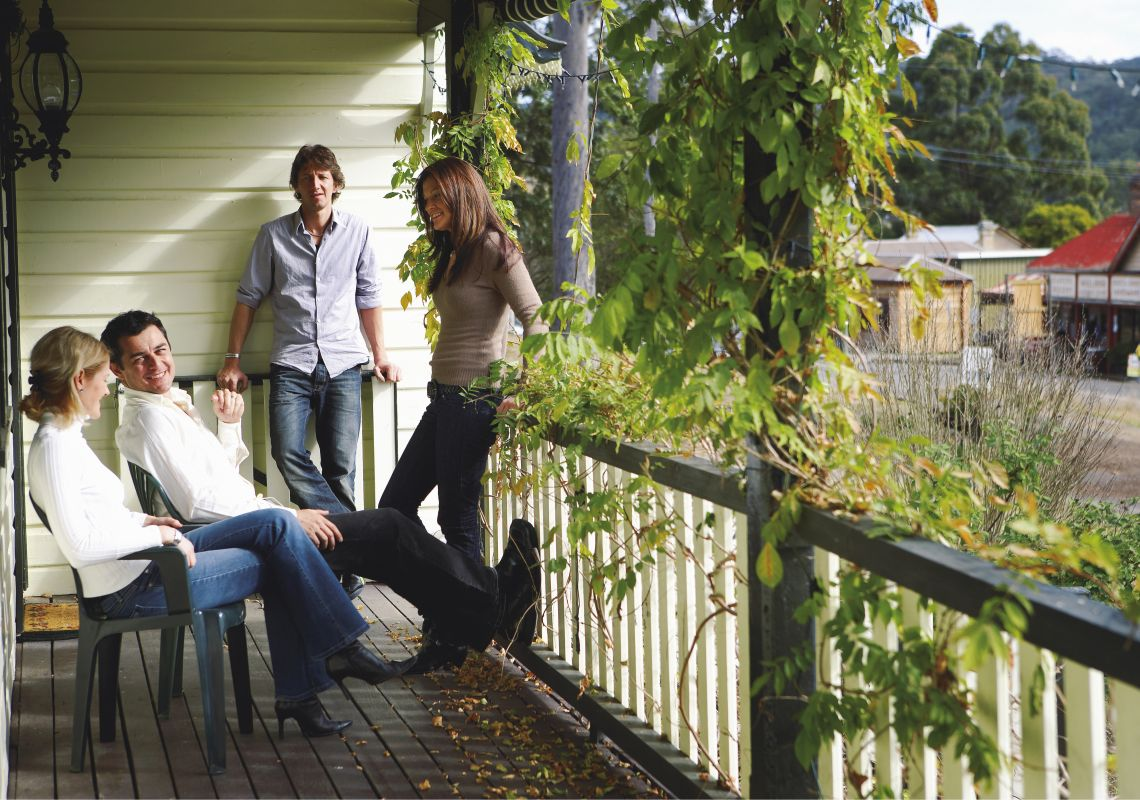 Friends relaxing on a front verandah in Wollombi